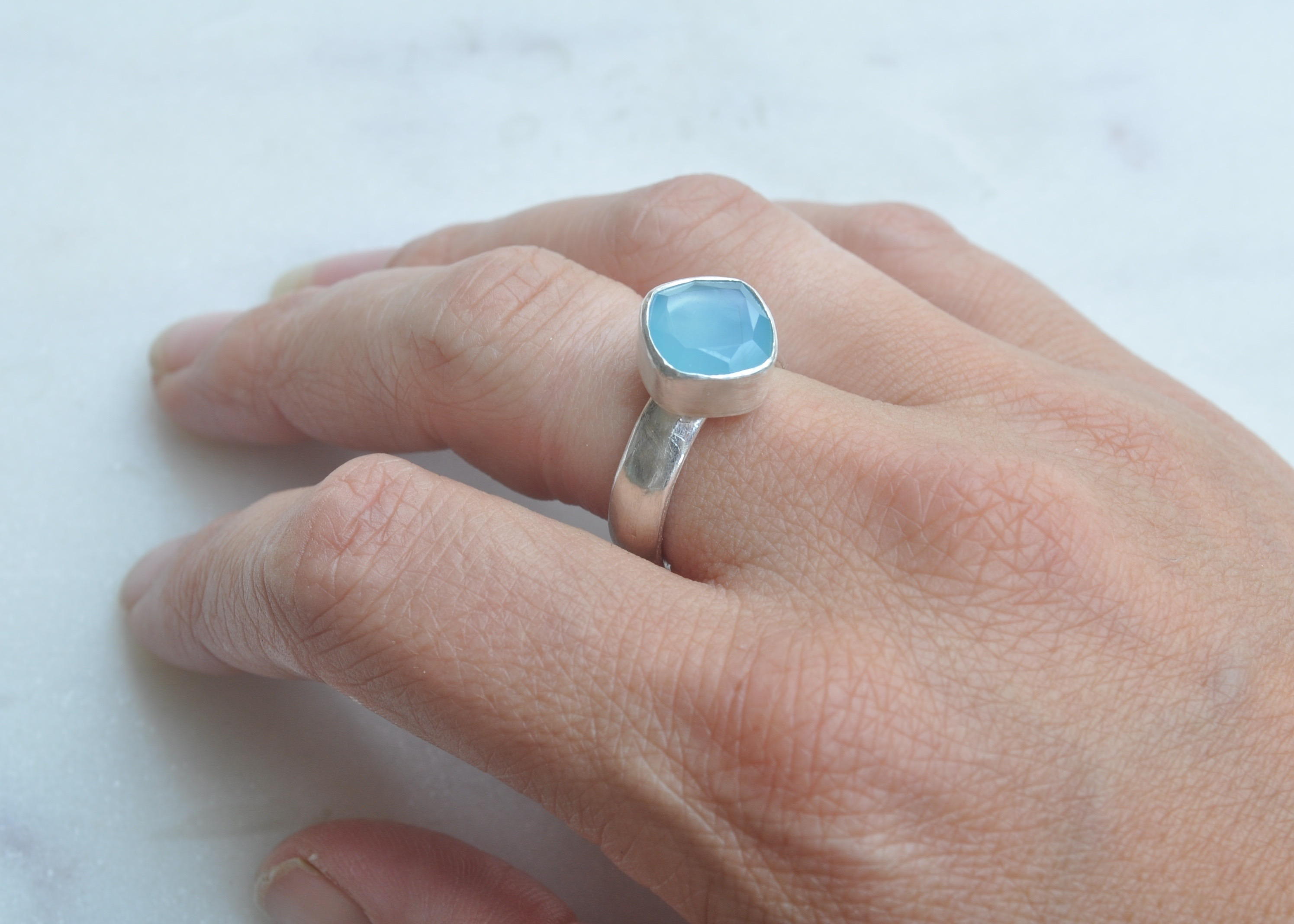 One off, limited edition designs. By Clare Quinlan. Aquamarine cushion cut stone set on a chunky sterling silver band.