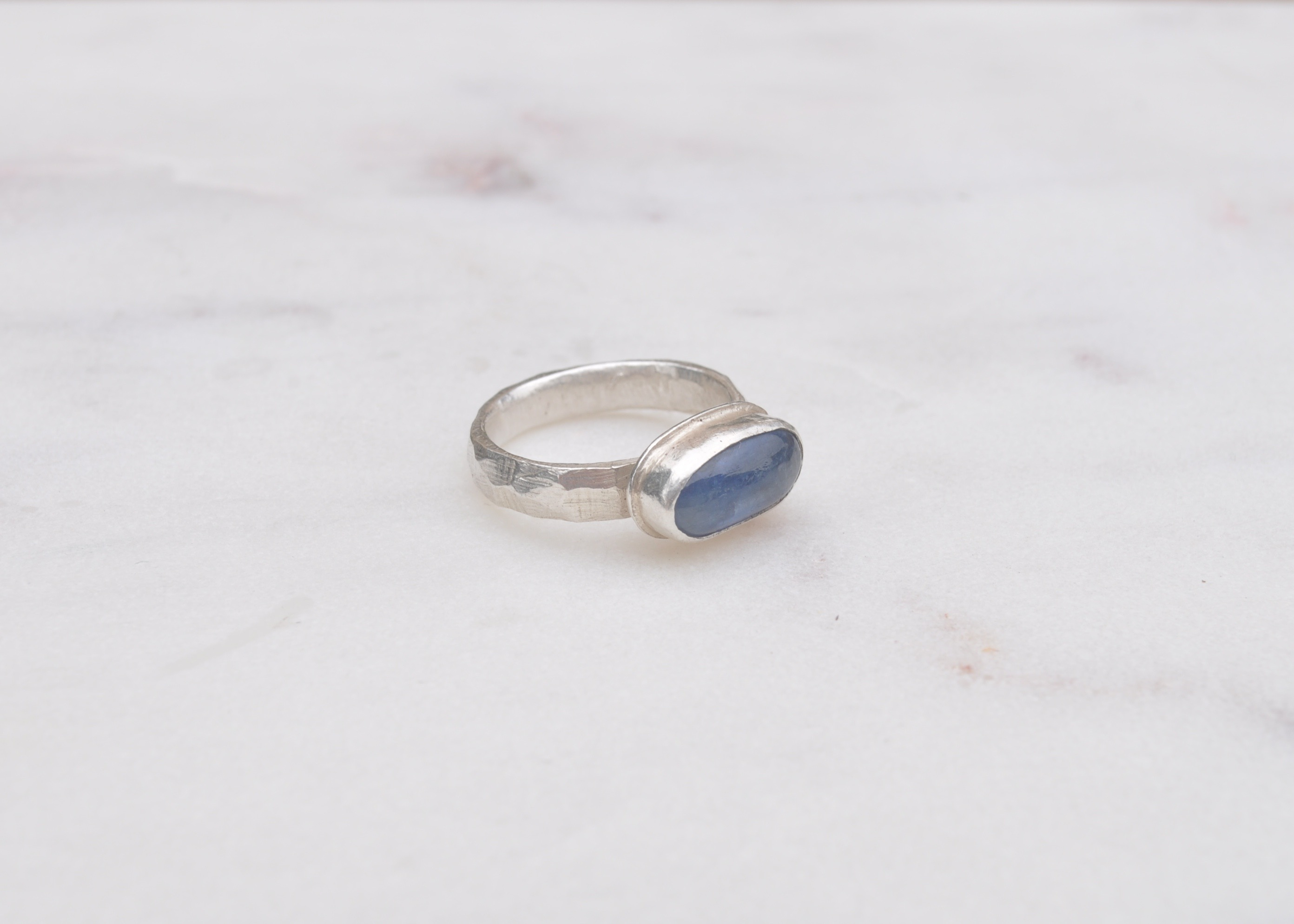 One off, limited edition designs. By Clare Quinlan. Kyanite stone set on a faceted sterling silver band.