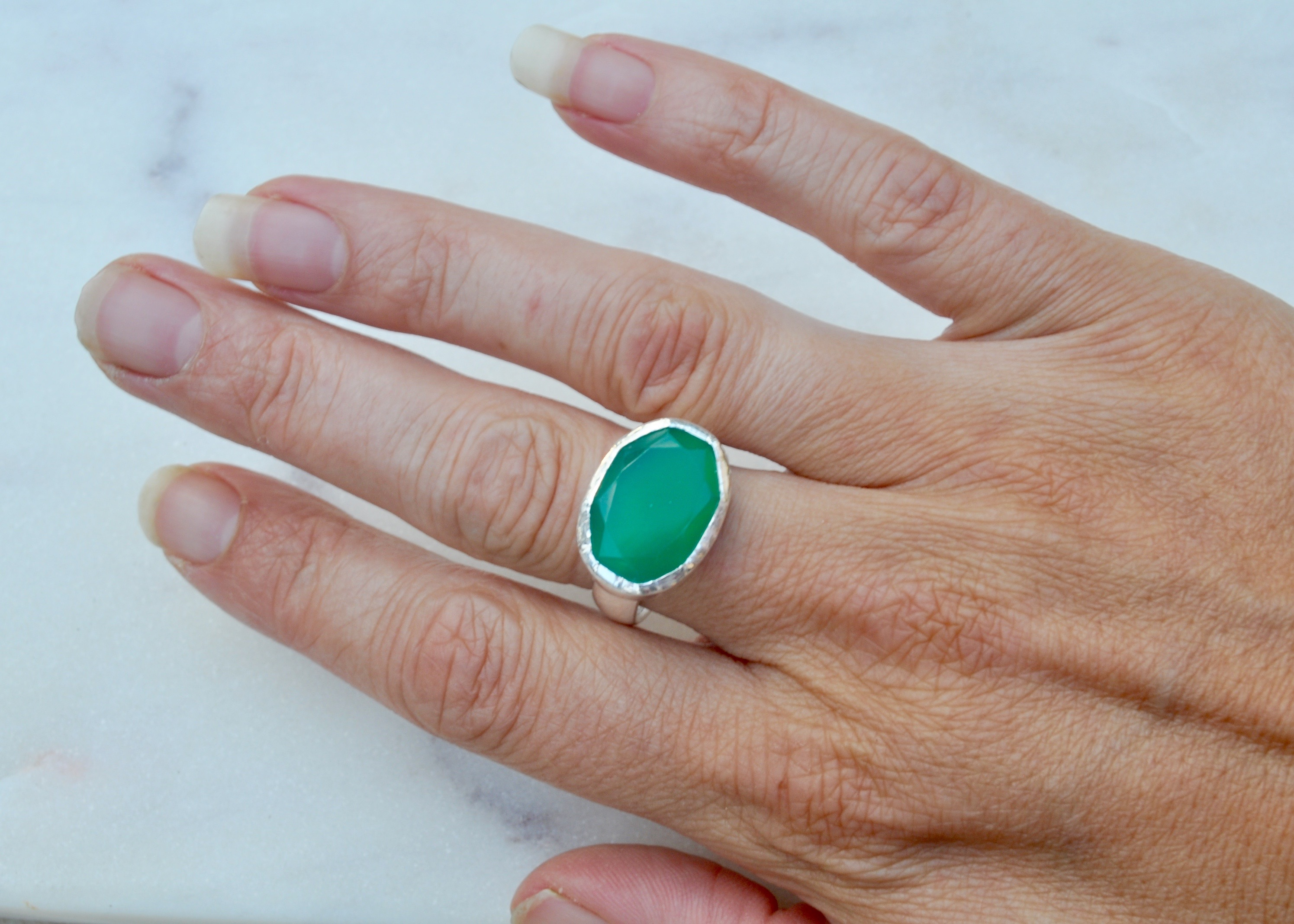 Green Onyx stone set on a sterling silver band.
