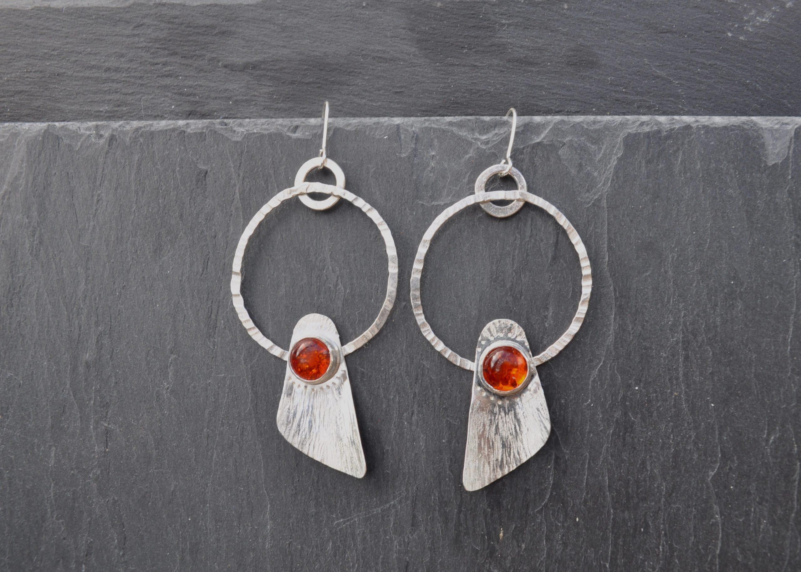 Amber set in sterling silver, seed pod inspired earrings.