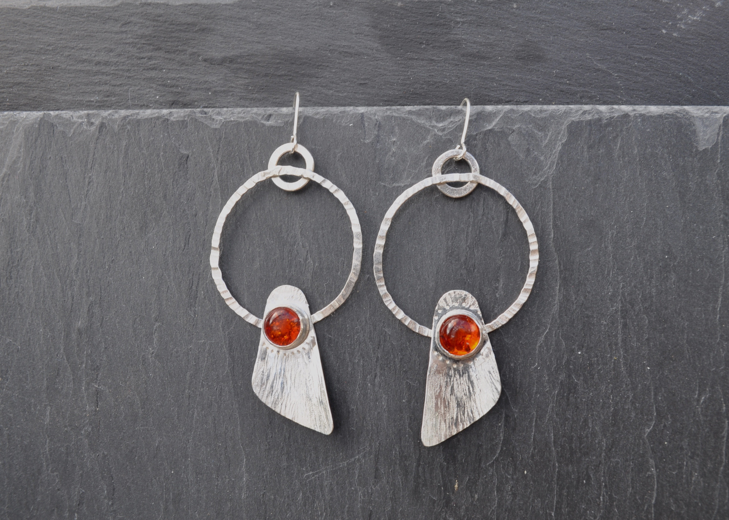 Amber set in sterling silver, seed pod inspired earrings.